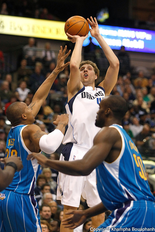 Dallas Mavericks' Dirk Nowitzki makes a shot against the New Orleans Hornets during an NBA basketball game at American Airlines Center in Dallas on February 28, 2010.   (Photo by Khampha Bouaphanh)