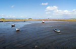 Boats at low tide, Holy Island, Lindisfarne, Northumberland, England, UK