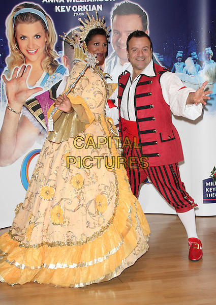 Deniece Pearson, Kev Orkian.'Cinderella' Pantomime Press Launch at Milton Keynes Theatre, Bucks, England..September 21st 2012.panto full length yellow costume white dress hand arm side want.CAP/JIL.©Jill Mayhew/Capital Pictures