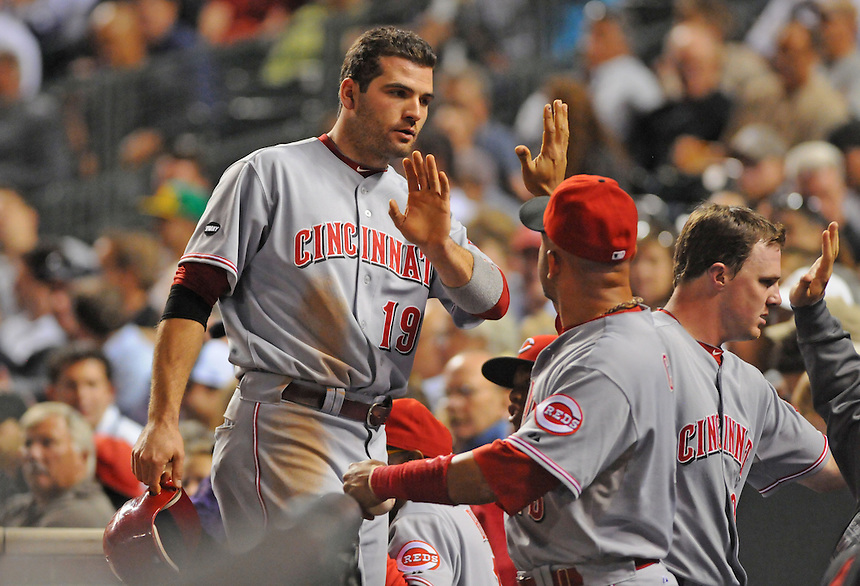 09 SEPTEMBER 2011: Cincinnati Reds first baseman Joey Votto (19) celebrates a run with teammates in the dugout   during a regular season game between the Cincinnati Reds and and the Colorado Rockies at Coors Field in Denver, Colorado.  The Reds beat the Rockies 4-1.  *****For Editorial Use Only*****