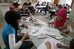 Palestinian students take part in a drawing session as part of a campaign calling for a Palestinian state with full UN membership at a school in the West Bank city of Nablus on September 17, 2011, as the Palestinians are preparing to submit a formal request to become the 194th member of the United Nations when the General Assembly begins its meetings on September 20, despite US and Israeli opposition . Photo by Wagdi Eshtayah