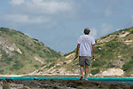At low tide Niel Bruce looks for isopods in and amongst the rocks around Lizard Island.  He specialises in isopod taxonomy and crustacean systematics and has been on the island to collect samples, record data and do the taxonomic work involved in finding new species of the crustacean.