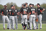 Brett Butler, Ichiro Suzuki, Cole Gillespie (Marlins),<br /> FEBRUARY 24, 2014 - MLB :<br /> Ichiro Suzuki of the Miami Marlins touches third base coach Brett Butler during the Miami Marlins spring training camp in Jupiter, Florida, United States. (Photo by AFLO)