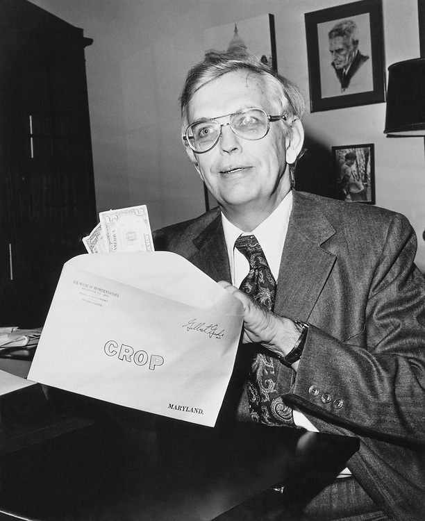 Rep. Gilbert Gude, R-Md. sitting in his office with envelope in hand in 1975. (Photo by CQ Roll Call)