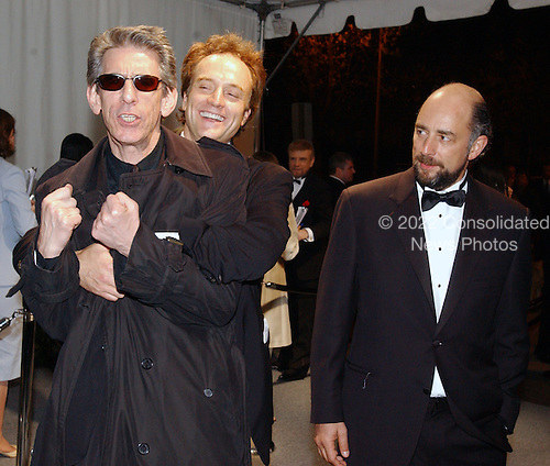 Bradley Whitfield playfully hugs Richard Belzer as Richard Schiff looks on quisically as they arrive for the  party  hosted by Bloomberg News following the 2003 White House Correspondents Dinner in Washington, DC on April 26, 2003..Credit: Ron Sachs / CNP