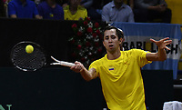 BOGOTA-COLOMBIA, 07-03-2020: Daniel Galan de Colombia devuelve la bola a Juan Ignacio Londero de Argentina, durante partidos de los enfrentamientos para Las clasificatorias Copa Davis by Rakuten 2020 entre Colombia y Argentina en el Palacio de los Deportes en la ciudad de Bogota. / Daniel Galan of Colombia returns the ball to Juan Ignacio Londero of Argentina during matches of the clashes for the Davis Cup by Rakuten 2020 qualifiers between Colombia and Argentina at the Palacio de los Deportes in Bogota city. / Photo: VizzorImage / Luis Ramirez / Staff.
