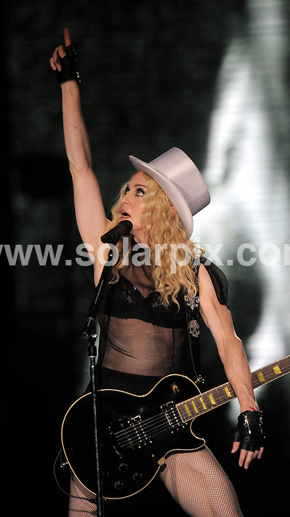 """**ALL ROUND PICTURES FROM SOLARPIX.COM**.**SYNDICATION RIGHTS FOR UK AND SPAIN ONLY**.Madonna on stage during her concert in the LTU arena in Duesseldorf. The concert in Duesseldorf was part of her spectacular """"Sticky and Sweet"""" world tour..JOB REF:  7231    CPR / DDP       DATE: 05.09.08.**MUST CREDIT SOLARPIX.COM OR DOUBLE FEE WILL BE CHARGED* *UNDER NO CIRCUMSTANCES IS THIS IMAGE TO BE REPRODUCED FOR ANY ONLINE EDITION WITHOUT PRIOR PERMISSION*"""