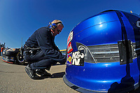 Checking tire pressure on the car of Bobby Labonte, (#47).