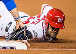 13 October 2016: Washington Nationals outfielder Bryce Harper dives back to first on a pick-off attempt during Game 5 of the NLDS against the Los Angeles Dodgers at Nationals Park in Washington, DC. The Dodgers edged out the Nationals 4-3, to take Game 5 of the Series, 3 games to 2, and move on to the National League Championship Series against the Chicago Cubs. Mandatory Credit: Ed Wolfstein Photo *** RAW (NEF) Image File Available ***