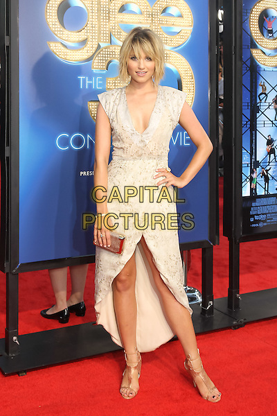 DIANNA AGRON .The 20th Century Fox 'Glee 3D' Concert World Movie Premiere held at The Regency Village theatre in Westwood, California, USA,.August 6th 2011..full length dress bob fringe white grey gray print beige clutch bag nude sandals gold wrap hand on hip.CAP/CEL.©CEL/Capital Pictures