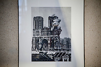 Photograph taken on September 1914 showing the southern tower of the Notre-Dame de Reims cathedral on fire on display at the Palais du Tau which adjoins the cathedral, Reims, France, 10 November 2015.