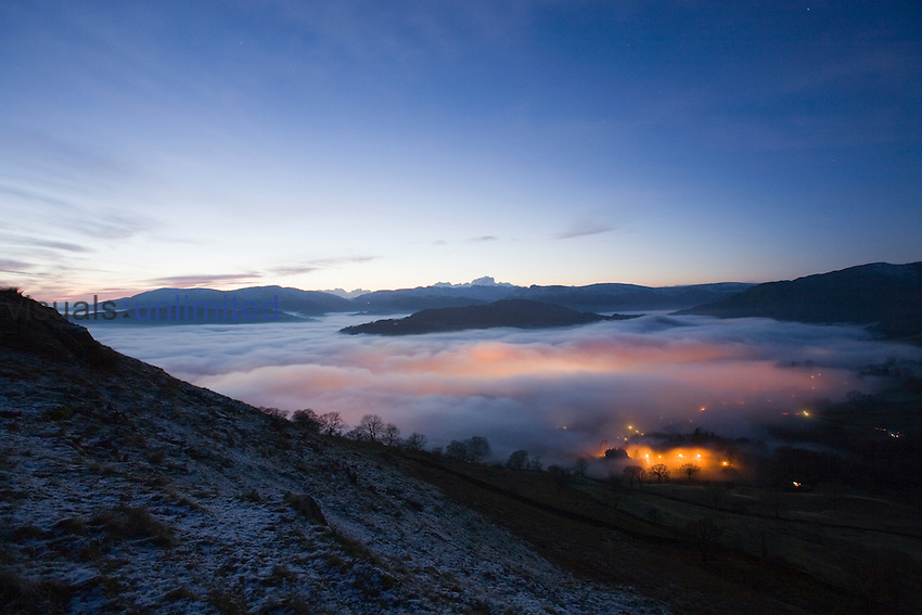 Valley fog or mist over Ambleside from Wansfell Pike in the Lake District, UK