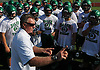 Buddy Krumenacker, Farmingdale varsity football head coach, talks to his players during practice at Farmingdale High School on Tuesday, Aug. 16, 2016.
