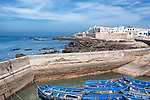 Coastal town Essaouira with sea and blue boats.