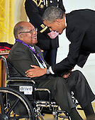 United States President Barack Obama presents the 2012 National Medal of Arts to author and teacher Ernest J. Gaines during a ceremony in the East Room of the White House in Washington, D.C.  on Wednesday, July 10, 2013.<br /> Credit: Ron Sachs / CNP