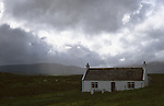 Isolated cottage on the Isle of Skye,  Highlands of Scotland UK