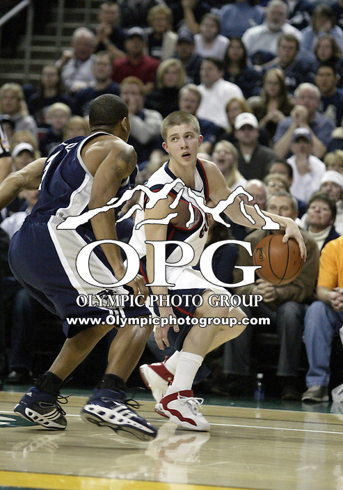 "30 December 2005:  Gonzaga Bulldogs #5 Derek Raivio sets up to make his move to the hoop against the Nevada Wolf Pack at Key Arena in the fourth annual ""Battle of Seattle"" Seattle, WA. Nevada won 82-74 over the Gonzaga Bulldogs."