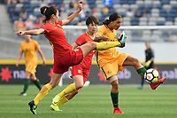 26 November 2017, Melbourne - WU HAIYAN (5) of China PR attempts to block SAM KERR (20) of Australia during an international friendly match between the Australian Matildas and China PR at GMHBA Stadium in Geelong, Australia.. Australia won 5-1. Photo Sydney Low