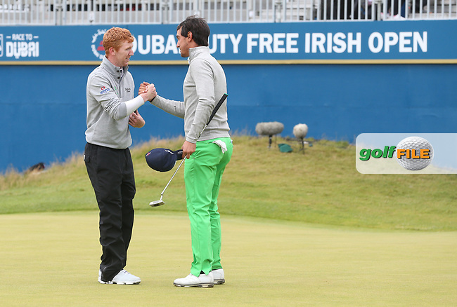 /{prsn}/ shakes the hand of Matteo Manassero (ITA) at the last during the Final Round of the Dubai Duty Free Irish Open 2017 Hosted by the Rory Foundation, at Portstewart Golf Club, Derry, Northern Ireland.  09/07/2017. Picture: David Lloyd | Golffile.<br /> <br /> Images must display mandatory copyright credit - (Copyright: David Lloyd | Golffile).