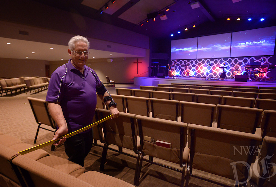 NWA Democrat-Gazette/BEN GOFF @NWABENGOFF<br /> Dave Cooper checks the positioning of seats as church members reconfigure the auditorium on Saturday June 4, 2016 during a ribbon-cutting and 'big reveal' for the newly renovated auditorium at New Life Christian Church in Bella Vista. The church was opened in 1974 as Bella Vista Christian Church and has undergone several expansions over the years. The church rebranded itself New Life Christian at the beginning of the year and began the renovation project for the auditorium on March 28.