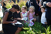 First Lady Michelle Obama signs a program for children at the Pentagon in Arlington, Virginia, on the tenth anniversary of the 9/11 attacks against the United States, Sunday, September 11, 2011..Mandatory Credit: Pete Souza - White House via CNP