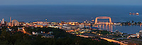 Canal Park and the aerial lift bridge in Duluth, Minnesota at night as viewed from Enger Tower.