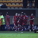 Jamille Matt of Kidderminster (20) celebrates with team-mates after scoring the late winner during the Blue Square Bet Premier match between Cambridge United and Kidderminster Harriers at the Abbey Stadium, Cambridge on 18th February, 2011 .© Kevin Coleman 2011.