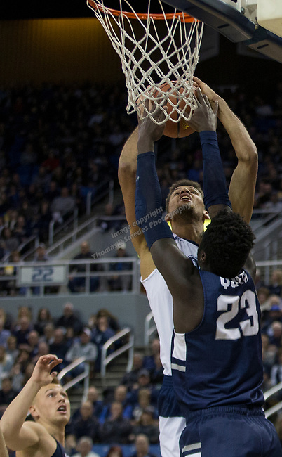 Nevada forward forward Trey Porter's shot blocked by Utah State center Neemias Queta (23) in the first half of an NCAA college basketball game in Reno, Nev., Wednesday, Jan. 2, 2019. (AP Photo/Tom R. Smedes)