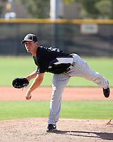 Kenneth Roberts #93 of the Colorado Rockies pitches in a minor league spring training game against the San Francisco Giants at the Giants minor league complex on March 30, 2011  in Scottsdale, Arizona. .Photo by:  Bill Mitchell/Four Seam Images.