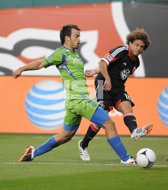 D.C. United midfielder Nick DeLeon (18) makes a pass against Seattle Sounders defender Patrick Ianni (4)  D.C. United tied the Seattle Sounders, 0-0 at RFK Stadium, Saturday April 7, 2012.
