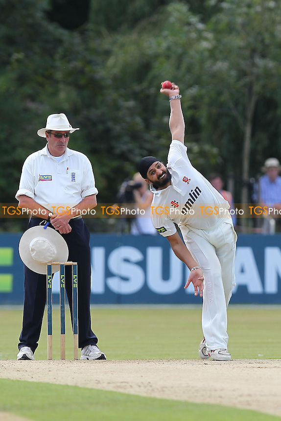 Monty Panesar bowls in his first over for Essex CCC - Essex CCC vs Northamptonshire CCC - LV County Championship Division Two Cricket at Castle Park, Colchester Cricket Club - 20/08/13 - MANDATORY CREDIT: Gavin Ellis/TGSPHOTO - Self billing applies where appropriate - 0845 094 6026 - contact@tgsphoto.co.uk - NO UNPAID USE