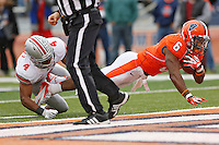 Illinois Fighting Illini running back Josh Ferguson (6) slips past Ohio State Buckeyes safety C.J. Barnett (4) for a fourth quarter TD  at Memorial Stadium in Champaign, Illinois on November 16, 2013.  (Chris Russell/Dispatch Photo)