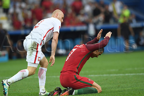 30.06.2016. Marseille, France.  Cristiano Ronaldo of Portugal reacts to the push in the back from Michal Pazdan (L) of Poland during the UEFA EURO 2016 quarter final soccer match between Poland and Portugal at the Stade Velodrome in Marseille, France, 30 June 2016.