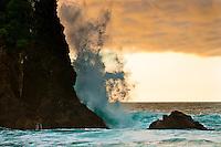 A wave on remote, wild West Coast beach at sunset - South Westland, West Coast, New Zealand