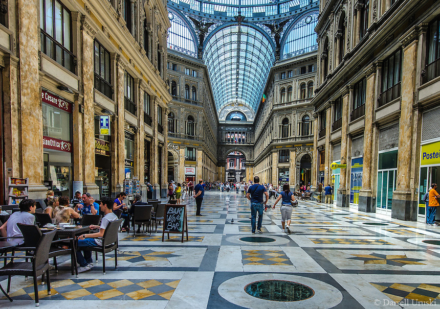 Fine Art Photograph of the Galleria Umberto I In the City of Naples. The street is covered by an arching glass and cast iron roof, a popular design for 19th-century arcades.<br />