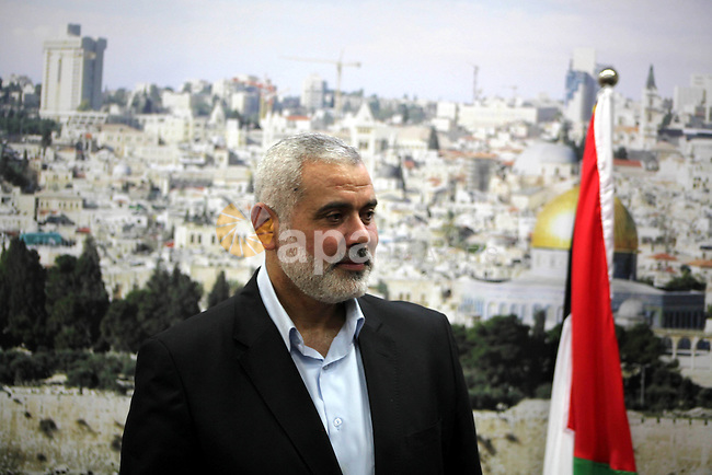 Palestinian Prime Minister in Gaza, Ismail Haniya Receives congratulations  in the Eid al-Adha, at his house in the Gaza Strip, on October 27, 2012. Muslims around the world celebrate Eid al-Adha to mark the end of the haj by slaughtering sheep, goats,  cows and camels to commemorate Prophet Abraham's willingness to sacrifice his son Ismail on God's command. Photo by Ashraf Amra