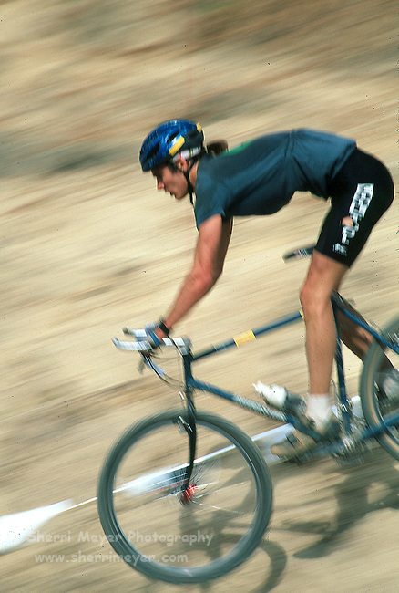 Mountain bike racer on a downhill section of the course
