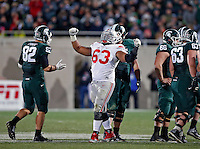 Ohio State Buckeyes defensive tackle Michael Bennett (63) celebrates a sack against Michigan State Spartans during the 4th quarter at Spartan Stadium in East Lansing, Michigan on November 8, 2014.  (Dispatch photo by Kyle Robertson)