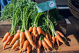 USA, Oregon, Ashland, Black Dog Farm carrots for sale at the Rogue Valley Growers and Crafters Market