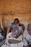 Pupils are learning Coran in the house of the marabout. They use wooden boards to write versets and read them during hours. The coranic schools in Timbuctu are only open early in the morning and on Saturdays in order to allow pupils to attend the public school.