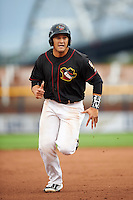 Quad Cities River Bandits third baseman Nick Tanielu (30) running the bases during the first game of a doubleheader against the Wisconsin Timber Rattlers on August 19, 2015 at Modern Woodmen Park in Davenport, Iowa.  Quad Cities defeated Wisconsin 3-2.  (Mike Janes/Four Seam Images)