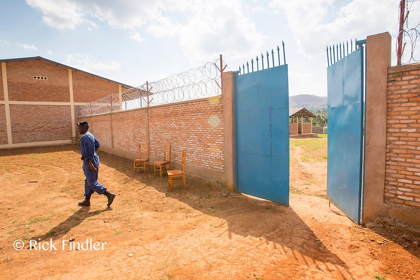 BURUNDI, Ruyigi: 10 June 2015 Ruyigi Re-education Centre Feature.<br /> See accompanying article for general information. <br /> Pictured: A police guard walks out of the re-education centre. The security is run by local police officers, not by prison guards.  <br /> Rick Findler / Story Picture Agency