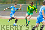 Strand Road's David Hennessy and Dan Kinsella of  Mitchells Ave keep their eyes on the ball, in the Denny KDL league game in Mounthawk Park on Sunday.