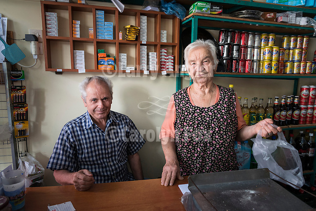 Shop keepers in their store at a small road-side store in Kastraki, Greece