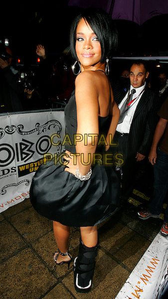 RIHANNA.The MOBO Awards launch at MO*VIDA, London, England..August 22nd, 2007.movida full length black dress hand on hip looking over shoulder cast leg injury .CAP/ROS.©Steve Ross/Capital Pictures