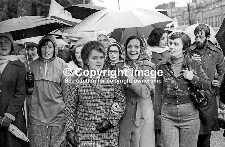 Peace People march on the Falls Road, Belfast, N Ireland, UK, 23rd October 1976, is headed by the organisation's leaders, Mairead Corrigan, holding umbrella, Betty Williams, also holding an umbrella &amp; behind Corrigan's left shoulder, and Ciaran McKeown, with beard extreme right. 197610230506b<br />