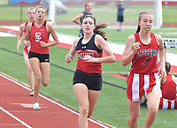 RICK PECK/SPECIAL TO MCDONALD COUNTY PRESS Ragan Wilson (left) is about to pass Jordan Kantola of West Plains to take fifth place in the 800 at Saturday's Missouri Class 4 Sectional 1 Track and Field Champions at West Plains High School.
