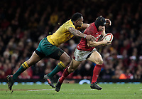 Wales' Leigh Halfpenny is tackled by Australia's Samu Kerevi<br /> <br /> Photographer Simon King/CameraSport<br /> <br /> International Rugby Union - 2017 Under Armour Series Autumn Internationals - Wales v Australia - Saturday 11th November 2017 - Principality Stadium - Cardiff<br /> <br /> World Copyright &copy; 2017 CameraSport. All rights reserved. 43 Linden Ave. Countesthorpe. Leicester. England. LE8 5PG - Tel: +44 (0) 116 277 4147 - admin@camerasport.com - www.camerasport.com