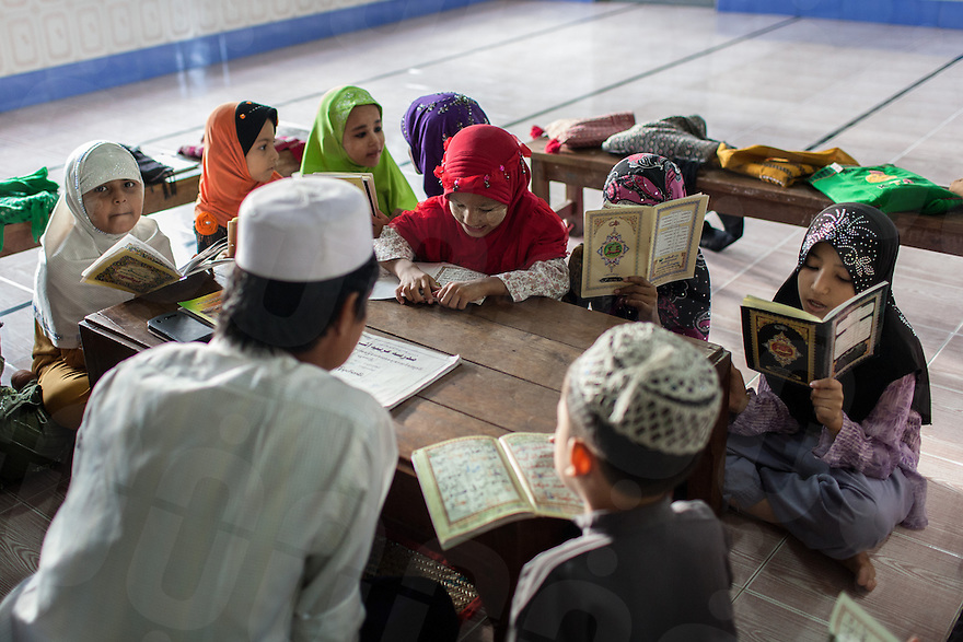 Young students in a Madrasa, near Joon Mosque in central Mandalay. 07 June 2013 © Nicolas Axelrod / Ruom