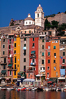 Portovenere, Italy. Close-up of colorful Mediterranean buildings on waterfront with laundry hanging out the windows.